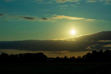 Bauernschaft im Abendlicht. Standort: Deutschland, Nordrhein - Westfalen, Borken