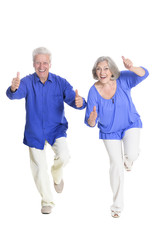 portrait of  senior couple with thumbs up