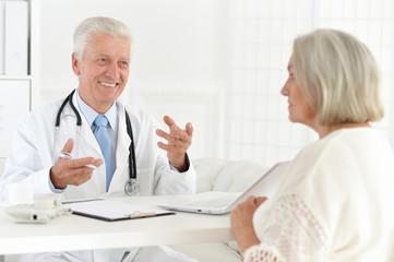 Portrait of senior doctor with a elderly patient
