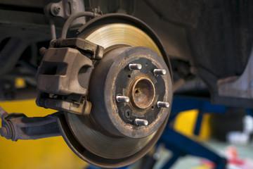 Car brake disc without wheels closeup.