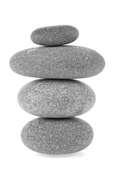 Pile of gray stones against white background. Spa stones. Pyramid.
