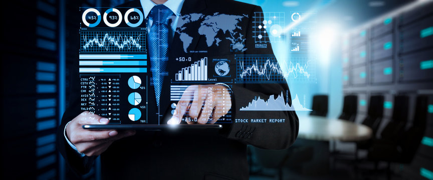 Investor analyzing stock market report and financial dashboard with business intelligence (BI), with key performance indicators (KPI).businessman hand working with finances