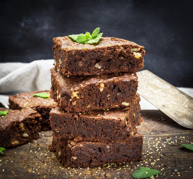 baked square pieces of chocolate brownie pie with walnuts