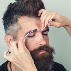 Permanent Makeup For Eyebrows. Close up Of Handsome Man With Thick Brows In Beauty Salon. Beauty Procedure. High Resolution. Brutal Male With Beard Gets Eyebrow Correction Procedure. Plucking Brows
