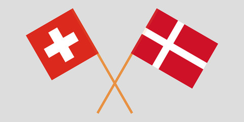Switzerland and Denmark. Crossed Swiss and Danish flags. Official colors. Correct proportion. Vector