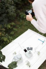 Professional photographer makes photos for the stock. Girl taking pictures of subjects on a white background.