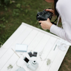 Girl photographer takes pictures of objects. Female hands hold the camera. Woman working with stock photography
