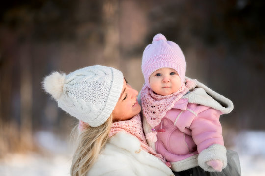 Beautiful Mother and daughter winter portrait