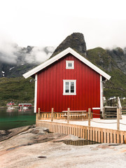 Norway traditional architecture house rorbu and rocky mountains scandinavian travel view landscape, Lofoten islands in Norway