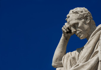 Man statue in the act of thinking against blue sky. Ancient Roman Julian the Jurist statue erected at the end of 19th century in front of the Old Palace of Justice in Rome (with copy space) Wall mural