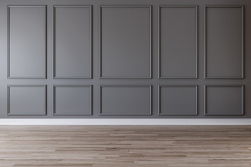 Empty room with dark gray wall, moldings and wooden floor
