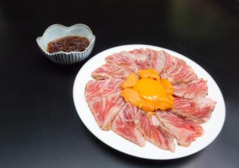 Wagyu A5 slice with hokaido yolk egg and hokaido uni serve with special sauce