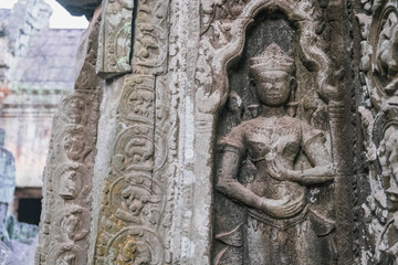 Beautiful Cambodian women dancing Apsaras. Old Khmer art carvings on the wall of Ta Prohm Temple, Siem Reap, Cambodia. Ta Prohm is in much the same condition in which it was found