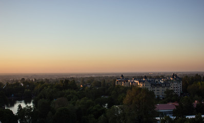 view of the city and the lake at sunset in Almaty