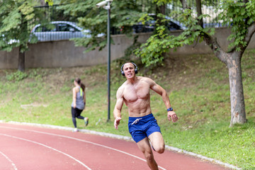 Muscular Man Running in the Park