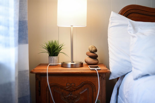 Nightstand with smartphone charging - finding balance concept