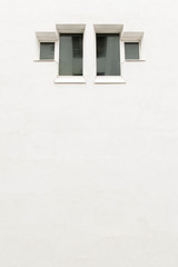 Minimalist window on empty wall. Residential building.