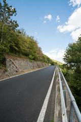 a road along the mountain