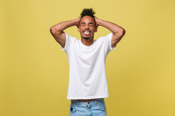 Portrait of angry or annoyed young African American man in white shirt looking at the camera with displeased expression. Negative human expressions, emotions, feelings. Body language.