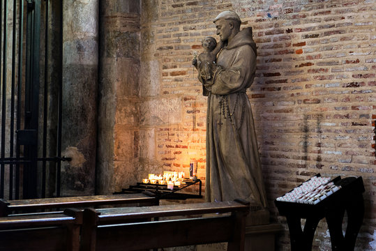 Saint Anthony of Padua holding baby Jesus statue in Saint Sernin church, Toulouse, France. It is a church destination of pilgrimage on the way to Santiago of Compostela