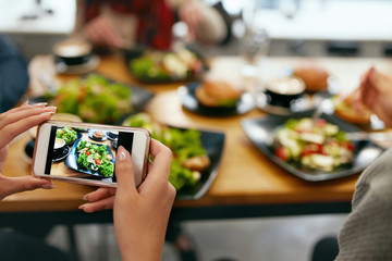 Photo On Phone. Closeup Woman Hands Photographing Food