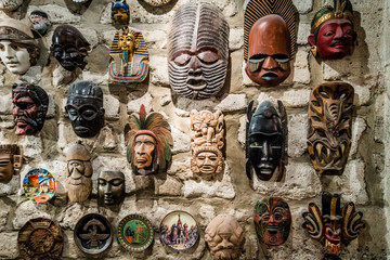 masks hanging on wall. Collection of  masks