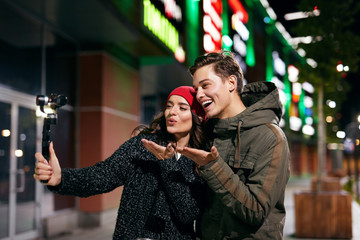 People Video Blogging On Camera On Street. Couple Taking Photos