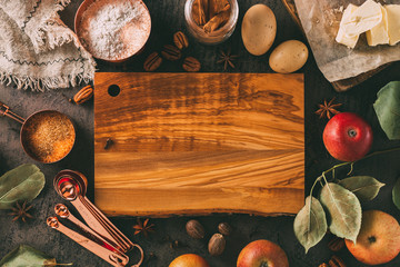 Empty chopping board and ingredients for baking. Wall mural