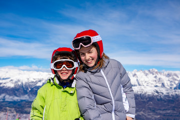Happy children on the snow in the high mountains