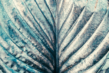 Silver metal painted green organic leaf as abstract creative art wallpaper or backdrop for design,...