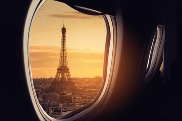 Eiffel as seen through window of an aircraft.