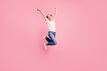 Full length size body studio photo portrait of cheerful glad rejoicing pretty nice charming cute lovely sweet girl jumping up isolated on pastel pink background