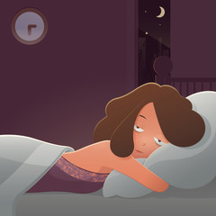 Woman lying in bed suffering from insomnia.