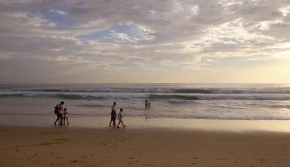 Beautiful sunset on Karon beach. The surf pounds the shore. Phuket, Thailand