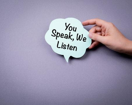 You speak, we listen. Speech bubble on a gray background