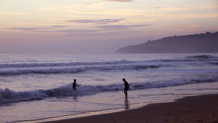 Beautiful sunset on Karon beach. The surf pounds the shore. Phuket, Thailand