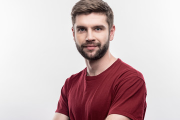 Handsome man. Image without face retouching with bearded dark-haired handsome man wearing dark red shirt