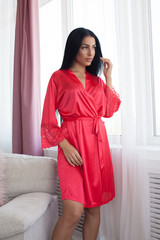 Beautiful sexy woman wear silk pajama style casual girl with dark hair fashion catalog lady perfect face cosmetic and body makeup meeting walk interior room.
