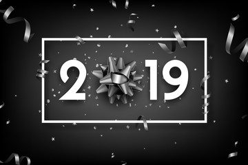 Black 2019 happy New Year card with grey bow and serpentine.