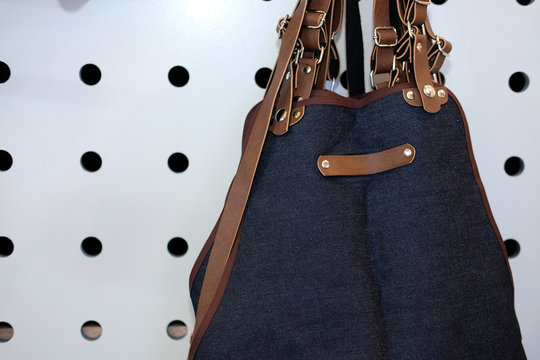 blue jeans denim & brown leather apron