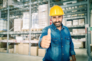 smiling handyman in warehouse