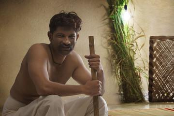 Portrait of Indian farmer holding hoe