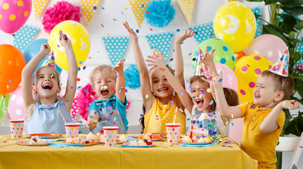 children's birthday. happy kids with cake