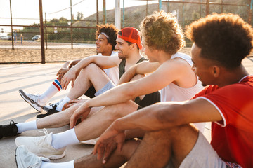 Group of young multiethnic men basketball players