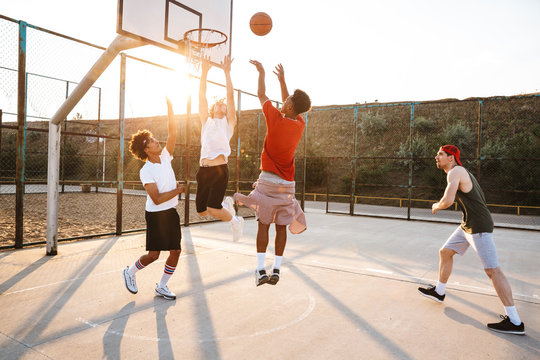 Group of young sporty multiethnic men basketball players