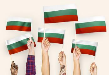 Hands waving flags of Bulgaria