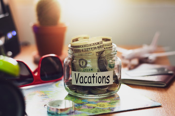 Vacation budget concept. Money for vacations savings in a glass jar.