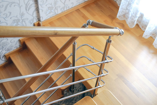 Modern wooden staircase in the house. The view from the top.