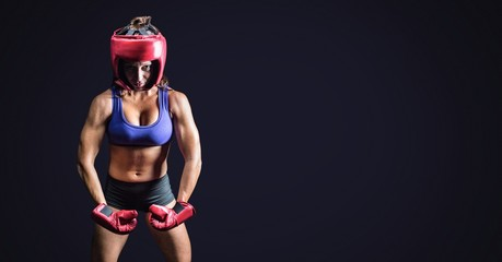 Female boxer with blank dark background
