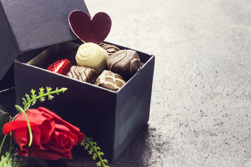 various chocolate in  gift box with  red flower  for valentine's day